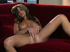 A pleasurable girl takes off her black dress and then lies down on a red sofa. This beauty shows off her boobs and plays with her pussy.
