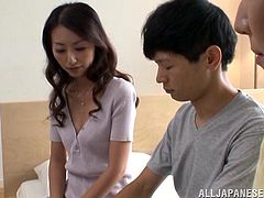 This guy worked his magic and hooked up with two hot Japanese MILFs at once. Her fingers one while the other sucks his cock.