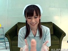 Pretty Yuuka Aoyama makes a guy cum using just her hands. This Asian babe gives a handjob with a smile on her face.
