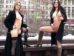 Amateur babes are posing outdoors when cold