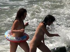 Voyeur must have an amazing time while spying on these beautiful girls enjoying day at the beach
