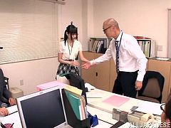 Sexy Japanese couple snick to the office toilet and the lovely lady gives a superb deep throat blowjob as she strokes the hard cock until he cums on her face