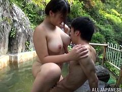 Horny Asian bitch is playing dirty games with a man outdoors. She pleases him with a blowjob and then leans forward and gets her snatch banged from behind.