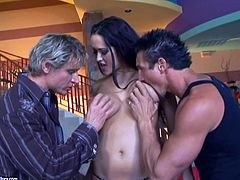 Press play on this hardcore scene and take a look at Carmella Bing's big round tits before this slutty brunette is fucked by two guys in a threesome.