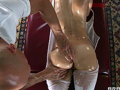 Make sure you get a load of this hardcore scene where the sexy Jenni Lee gets an oil massage before she sucks and fucks his large cock.