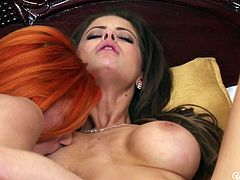 Bosomy red haired chick Ariel has hot sex with her brunette babe Emily Addison
