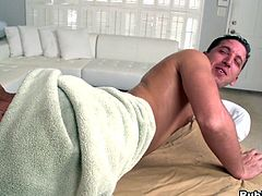 While getting his body rubbed down, the hung, strong masseuse spreads his ass and rims him then bends him over the table and fucks him.