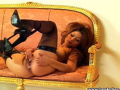 Pretty porn star in high heels lifts her legs showing off her hot ass then pleasures herself fingering her pussy as she screams in sheer amazement