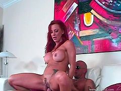 A kinky big-breasted mom masturbates her twat on a sofa. Then she sits down on a guy's prick and they bang in the reverse cowgirl position.