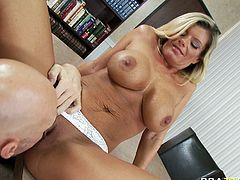 Kinky blond haired MILF Kristal Summers blows hard cock of porn boy Johnny Sins