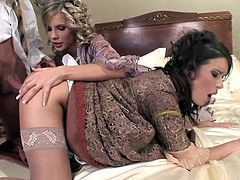 Lara Croft and Tiffany Russo wearing medieval dresses make out in a bedroom and pet each other. Then they give a blowjob to a dude and get their snatches fucked deep.