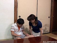 Mature Japanese bitch Yuuri Saejima kneels in front of a man and begins to suck his schlong. She also rubs it ardently like a pro and enjoys herself.