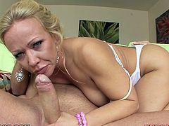 Bosomy MILF with phat ass Austin Taylor treats huge dick with blowjob