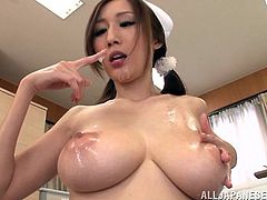 Julia is a pigtailed Japanese nurse. She gives a handjob and a blowjob to a lucky patient. She also takes off her uniform and gets titty fucked.