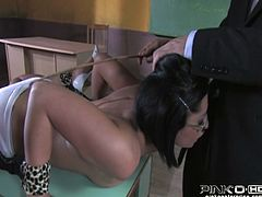 Short and black haired hottie in glasses got roped and lied on table. That freaky horny man took out his staff penis and set to fuck her dirty mouth greedily. Look at that steamy oral sex in Pinko HD sex video!