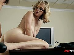 Be part of this video where a blonde MILF, with a nice ass wearing glasses, gets her pussy smashed by a horny dude over a desk in an office.