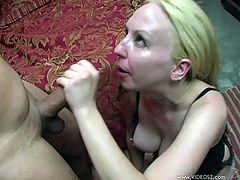 Salacious blonde mom Zoe Matthews wearing a bra, kneels in front of a guy and begins to suck his dick. She also licks the dude's balls and soon gets a cumshot in her mouth.
