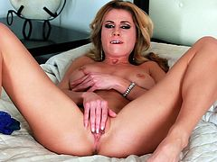 Busty blonde mom Randy Moore is getting naughty in a bedroom. She takes her panties off and shows her cunt for the camera, then pleases herself with fingering.