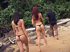 Here are these two delicious bunnies and they are so eager to suck that huge black cock! The whole threesome action takes place one the beach!