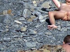 Nudist chick is getting naked on the beach