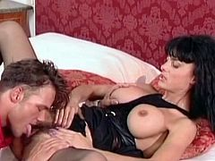 She looks dashing in her black lingerie and with the legs wide open to engulf large dong inside her fanny