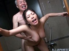 Have a good time watching this Japanese MILF, with natural boobs wearing a bathing suit, while she gets fucked hard in the shower.