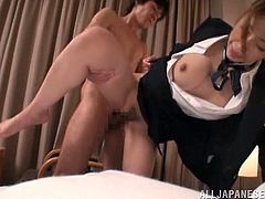 Sexy Japanese stewardess gives a titjob and rides a dick