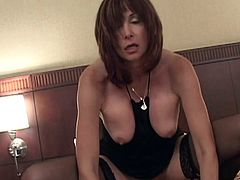 Dark-haired mom Staci Filmore shows her flabby tits to a guy and gives him a blowjob. Then they fuck in the side-by-side position and doggy style.