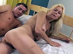 Filthy blonde mom with hairy pussy is fucked bad in a missionary position. She then lies on her side taking hard dick from behind.
