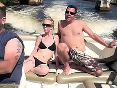 Petite Angie Scott and her boyfriend have a river tour on a yacht. Angie gets so horny that takes a bikini off and starts to suck a dick. Then the girl gets fucked in her shaved pussy.