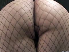 Horny ass bitch with big boobs poses for camera wearing fishnet pantyhose. Thirsty dude takes her solid pecker in his mouth performing deepthroat blowjob.