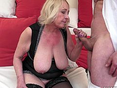 Make sure you see this! A blonde mature lady, with giant breasts wearing nylon stockings, while she goes really hardcore and moans loudly.