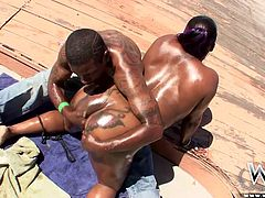 This dirty slut gets oiled up out by the swimming area and her man rubs her big, floppy ebony titties. She's on her knees sucking his thick rod hard and fast. Will he cum on this fat bitch? Watch and see.
