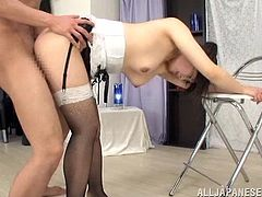 A slutty Japanese chick, wearing stockings and maid uniform, is having fun with a guy indoors. She gets fucked in the cowgirl position and pees on the floor in the end.