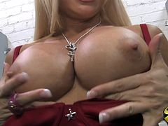 A stunning blonde MILF shows her big boobs and also sucks a big black cock passionately. She gets so damn horny that also takes the cock in her pussy.