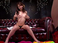 This dirty Japanese slut seductively poses on the couch and slowly undresses for her man. She takes off her bra and panties as her man plays with his rock hard erection. She climbs towards his cock and hovers over it as if she is about to give him a blowjob. She rubs herself as she is inches away from his cock.