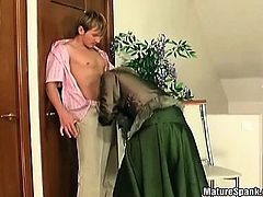 Busty granny is spanked by horny young part1