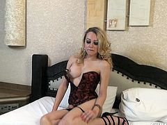 This amazingly buxom transexual leans forward and gives a nice view of her cleavage. Wouldn't you love to stick you face in her boobs? She unzips her corset, and then flashes her ass for the camera. Watch as she strips and jerks off.