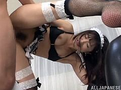 Sayuri Honjyou is a hot Japanese girl in housemaid uniform and fishnets. She sits on guy's face and then gets fucked in her hairy pussy.