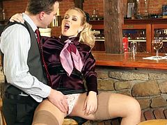 An amazing blonde chick talks to a barmen. She is the last client, so they are alone. Sweet Cat lifts up a skirt and gets her pussy licked. Then she give a blowjob and gets pounded on a bar counter.