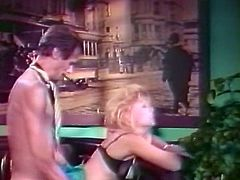 Curly and light haired dirty bitch with saggy breasts performed hard deep throat to her kinky stud right in cafe. Then he set to fuck her kitty from behind hard. Watch those shameless guys in The Classic Porn sex clip!