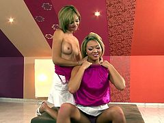 Natalia Forrest and Nikita take off their pink t-shirts and white miniskirts. They finger and lick each others shaved pussies lying on a bed.