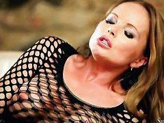 Silvia Saint has fire in her eyes as she strokes her muff