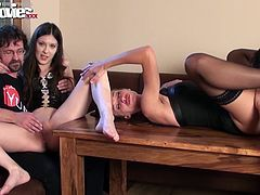 Are you a fan of amateur hardcore sex videos? Two horny ladies begin the erotic show in front of their male admirers. The excitement grows as the guys direct their attention to the slutty cunts, fingering or licking them. A guy lays on the table waiting to be blown while a sexy milf gets on her knees to suck.
