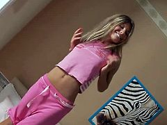 Cute teen babe Katherine has just woke up and she starts to take her clothes off. Watch as this cutie shows her perky tits to make you feel horny as hell...