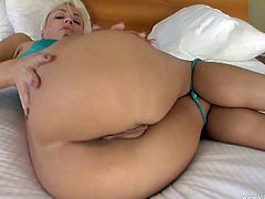 A beautiful blonde girl shows her nice booty lying on a bed. She give a skillful blowjob and then gets fucked in her hot pussy.