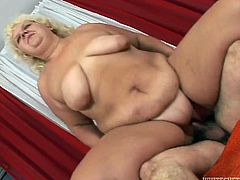 Disgusting BBW grandma makes a puddle squirting on bed. Fattie rides old flabby cock in reverse way and gets her loose twat fucked doggystyle.