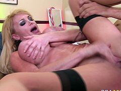 Sextractive blonde babe wearing black stockings gets her pussy drilled hard missionary style from behind. Her oiled up bouncing boobs will drive your cock crazy.