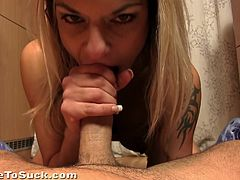 Click to watch this blonde babe, with big knockers and juicy lips, while she sucks a guy's rocket with passion until he cums in her mouth.