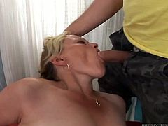 Lustful mature hoochie enjoys sucking meaty cock of one young dude living nextdoor. She swallows it and rolls her eyes with pleasure.